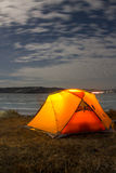 Yellow tent at night on the shore of lake Baikal in winter Stock Photography