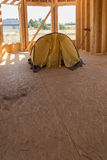 Yellow tent pitched inside the built house Royalty Free Stock Photography
