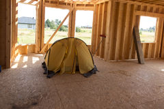 Yellow tent pitched inside the built house Royalty Free Stock Image