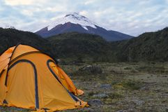 Camping in the Mountains. Yellow tent set in the mountains of Ecuadorian highlands. Taken at about 4000 mts above sea level. the volcano at the back is Cotopaxi Stock Photo