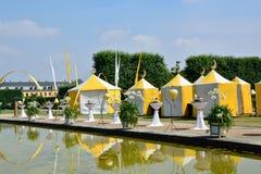 Yellow tents in Herrenhausen Gardens, Hannover, Lower Saxony, Ge Stock Photos