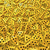 Yellow tetrahedron dice with three black eyes Royalty Free Stock Image