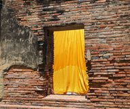 A yellow textile fabric hangs Royalty Free Stock Images