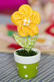 Yellow textile toy flower in flower pot Royalty Free Stock Image