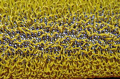 Yellow Texture. Abstract yellow textured loops of fibres on a perforated background Royalty Free Stock Photography