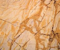 Yellow texture of marble panel as background stock photos