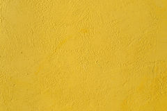 Yellow textured background. Fragment of the  yellow wall with decorative plaster Royalty Free Stock Images