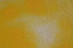 Yellow textured wall Stock Image