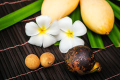 Yellow thai mango  with plumeria flower Stock Photography