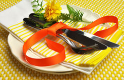 Yellow theme formal dinner table setting. Royalty Free Stock Image