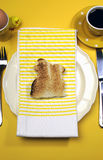 Yellow theme Happy Easter breakfast table with bunny rabbit toast - vertical Royalty Free Stock Photography