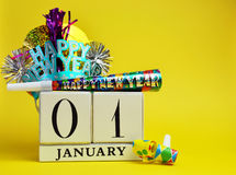 Yellow theme Save the date calendar for New Year, January 1. Mark the date, January 1, with this decorative calendar with Happy New Year hat and decorations Royalty Free Stock Images