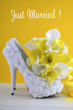 Yellow theme wedding shoes and bouquet Royalty Free Stock Images