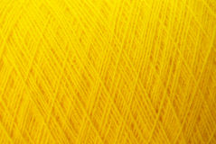 Yellow threads. Woolen bound yellow threads, background Stock Images