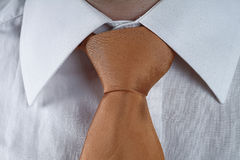 Yellow tie. A man with a yellow tie and white shirt stock image
