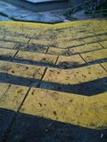 Yellow tiers of a park. Yellow cement steps in a park with gray metal railings Stock Image