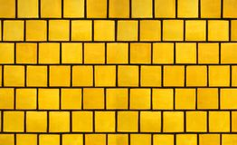 Yellow Tile Background. Shimery Yellow Brick Tile Background Stock Photo