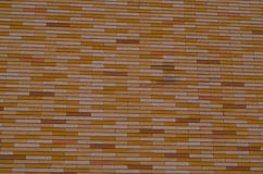 Yellow tile siding Stock Images