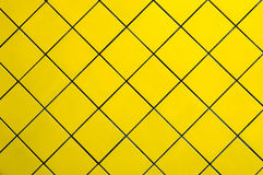 Yellow tile wall. Royalty Free Stock Photography
