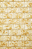 Yellow tiled wall Stock Photo
