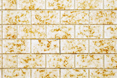 Yellow tiled wall Royalty Free Stock Image
