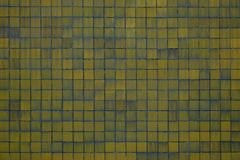 Yellow tiles background. Yellow grunge background with grunge tiles royalty free stock image