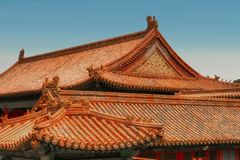 Horizontal view of golden chinese tile roofs. Forbidden City, Beijing royalty free stock photo