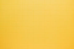 Yellow tile wall. Yellow tiles on the wall Royalty Free Stock Photos