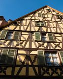 Yellow timber frame house in Alsace Royalty Free Stock Photography