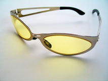 Yellow Tinted Sunglasses. Close up of a pair of stylish yellow tinted sunglasses royalty free stock image