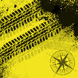 Yellow tire tracks with wind rose Royalty Free Stock Images