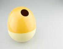 Yellow tissue box as egg Royalty Free Stock Photos