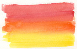 Yellow to red watercolor background. On textured paper stock photos