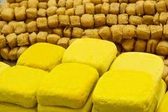 Yellow tofu in market, vegetarian food. Yellow tofu made from soybean in market, vegetarian food Stock Image
