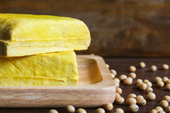 Yellow tofu and soybeans, Vegetarian food on wooden dish Stock Photos