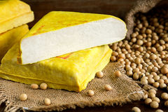 Yellow tofu and soybeans, Vegetarian food on wooden dish Stock Images