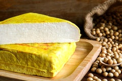 Yellow tofu and soybeans, Vegetarian food on wooden dish Royalty Free Stock Photo