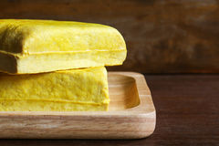 Yellow tofu, Vegetarian food on wooden dish. Yellow tofu and soybeans, Vegetarian food on wooden dish. tofu made from soybean is naturally gluten-free and low Royalty Free Stock Image