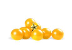 Yellow tomato. A shiny yellow tomato on white background with clipping path royalty free stock image