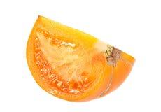 Yellow tomato slice Stock Image