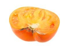 Yellow tomato slice Stock Images
