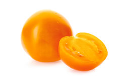 Yellow tomatoe with half slice on white Stock Images