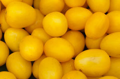 Yellow tomatoes. Background of fresh yellow tomatoes on a farmers market Royalty Free Stock Image
