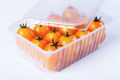 Yellow tomatoes in a container Royalty Free Stock Photo