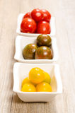 Yellow tomatoes in three bowls Stock Photos
