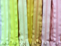 Yellow tone zip background. Sewing zip shade colorful Royalty Free Stock Photos