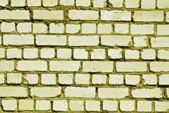 Yellow toned rough brick wall pattern. Stock Photos