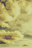 Yellow toned textured grungy cloudscape Stock Photography