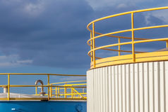 The yellow top of big industrial tanks farm in refinery industry Stock Photography