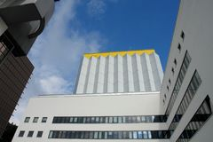 Yellow Top Building. These modern office buildings in Germany seem to touch the sky on a beautiful late August day Stock Photos